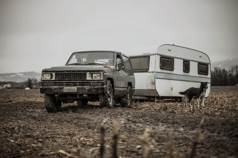 Land Rover towing a caravan in a muddy field